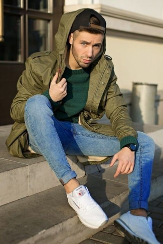 How to wear: white athletic shoes, blue skinny jeans, dark green crew-neck sweater, olive fishtail parka