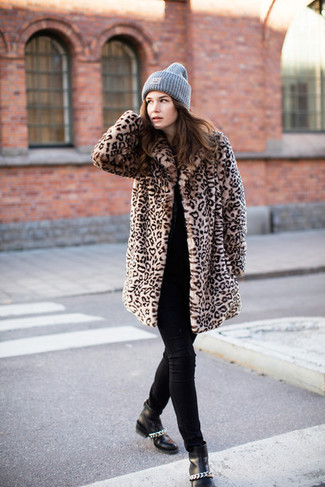 How to wear: black leather ankle boots, black skinny jeans, black crew-neck sweater, tan leopard fur coat