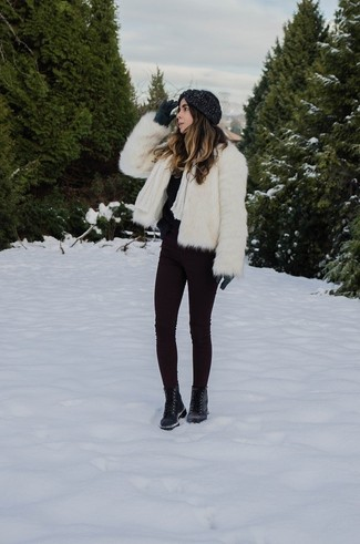 How to wear: black leather lace-up flat boots, dark purple skinny jeans, black fluffy crew-neck sweater, white fur jacket