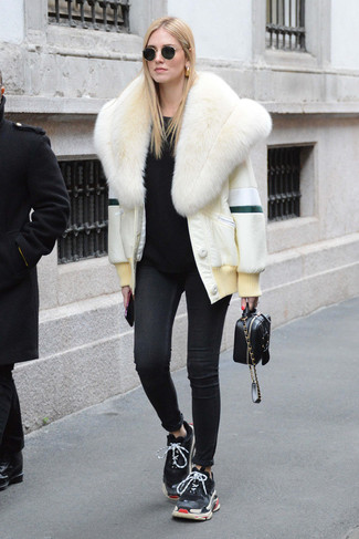 How to wear: black athletic shoes, black skinny jeans, black crew-neck sweater, white fur jacket