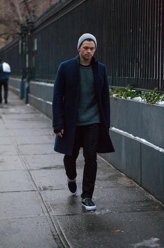 How to wear: black leather slip-on sneakers, black skinny jeans, dark green crew-neck sweater, navy overcoat