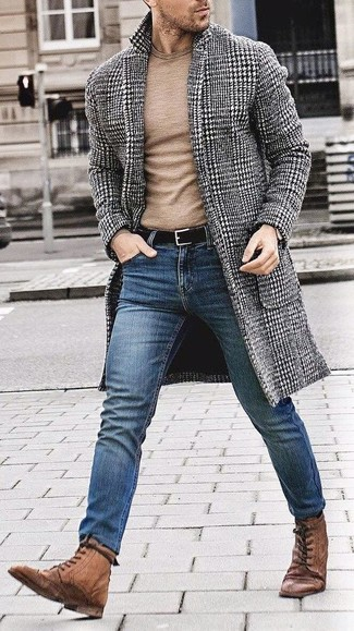 How to wear: brown leather brogue boots, blue skinny jeans, tan crew-neck sweater, black and white houndstooth overcoat