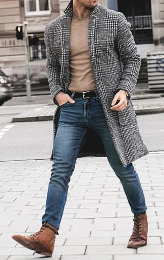 How to wear: brown leather casual boots, blue skinny jeans, tan crew-neck sweater, grey houndstooth overcoat