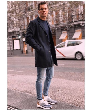 How to wear: white and navy athletic shoes, light blue ripped skinny jeans, navy crew-neck sweater, black overcoat