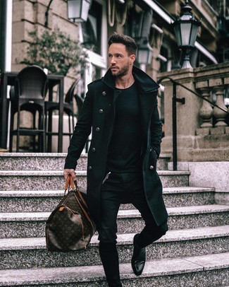 How to wear: black leather chelsea boots, black skinny jeans, black crew-neck sweater, black overcoat