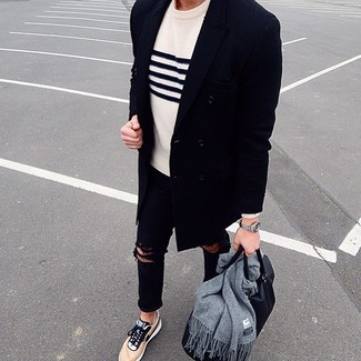 How to wear: tan low top sneakers, black ripped skinny jeans, white and navy horizontal striped crew-neck sweater, navy overcoat