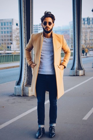 How to wear: black leather derby shoes, navy skinny jeans, grey crew-neck sweater, camel overcoat