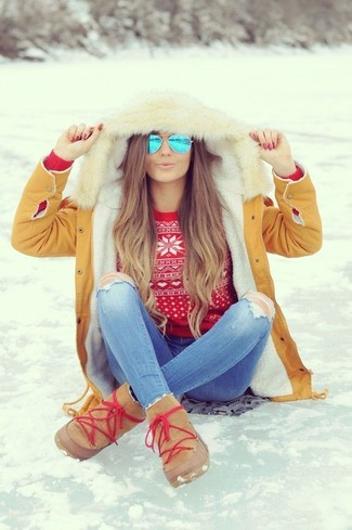 How to wear: tan uggs, light blue ripped skinny jeans, red fair isle crew-neck sweater, tan parka