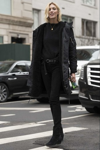 How to wear: black suede ankle boots, black skinny jeans, black crew-neck sweater, black parka