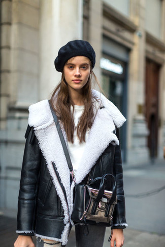How to wear: silver leather crossbody bag, grey ripped skinny jeans, white crew-neck sweater, black and white shearling jacket