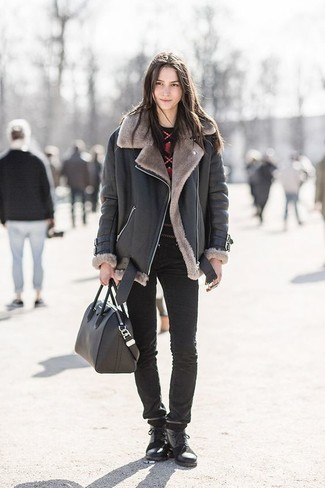 How to wear: black leather lace-up flat boots, black skinny jeans, red and black print crew-neck sweater, black shearling jacket
