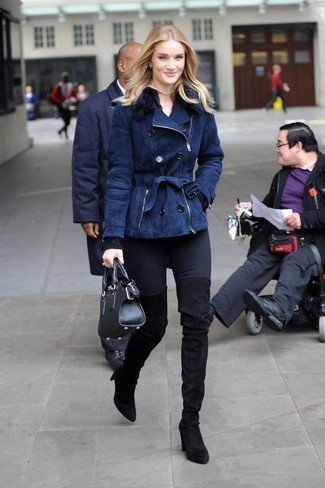 How to wear: black suede over the knee boots, black skinny jeans, black crew-neck sweater, navy shearling jacket