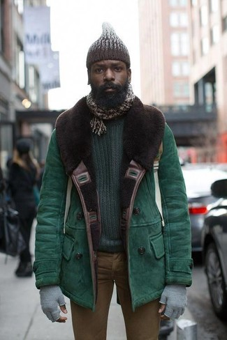 How to wear: dark brown knit beanie, brown skinny jeans, dark green crew-neck sweater, green shearling jacket