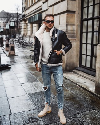 How to wear: beige suede chelsea boots, light blue ripped skinny jeans, white crew-neck sweater, black and white shearling jacket