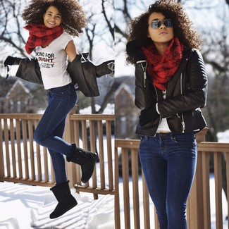 How to wear: black uggs, navy skinny jeans, white and black print crew-neck t-shirt, black leather biker jacket