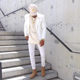 How to wear: tan suede chelsea boots, white skinny jeans, beige crew-neck t-shirt, white leather biker jacket