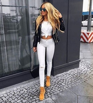 How to wear: tan suede lace-up flat boots, white ripped skinny jeans, white crew-neck t-shirt, black quilted leather biker jacket