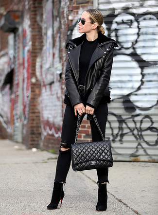 How to wear: black suede ankle boots, black ripped skinny jeans, black crew-neck t-shirt, black leather biker jacket