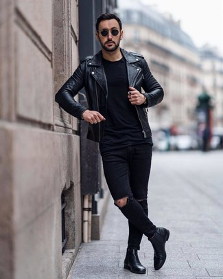 How to wear: black leather chelsea boots, black ripped skinny jeans, black crew-neck t-shirt, black leather biker jacket