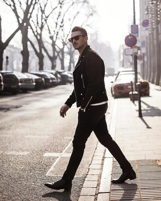 How to wear: black leather chelsea boots, black skinny jeans, white crew-neck t-shirt, black suede biker jacket