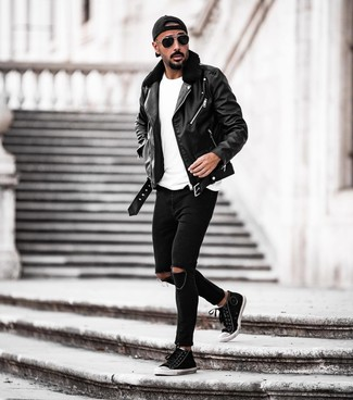 How to wear: black and white canvas high top sneakers, black ripped skinny jeans, white crew-neck t-shirt, black leather biker jacket