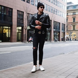 How to wear: white leather low top sneakers, black ripped skinny jeans, black crew-neck t-shirt, black leather biker jacket
