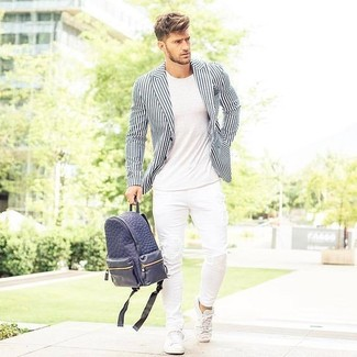 How to wear: white leather low top sneakers, white skinny jeans, white crew-neck t-shirt, white and black vertical striped blazer