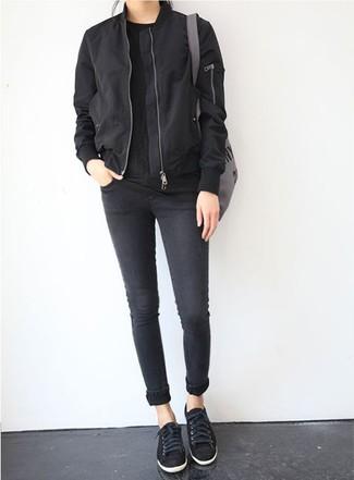 How to wear: black low top sneakers, black skinny jeans, black crew-neck t-shirt, black bomber jacket