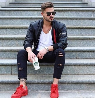 How to wear: red low top sneakers, black ripped skinny jeans, white crew-neck t-shirt, black leather bomber jacket
