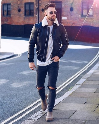 How to wear: grey suede chelsea boots, black ripped skinny jeans, white and black print crew-neck t-shirt, black leather bomber jacket