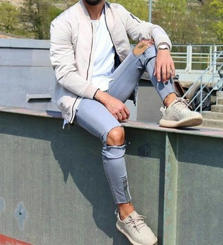 How to wear: beige athletic shoes, light blue ripped skinny jeans, white crew-neck t-shirt, beige bomber jacket