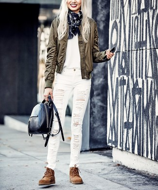 How to wear: brown suede lace-up flat boots, white ripped skinny jeans, white crew-neck t-shirt, olive bomber jacket