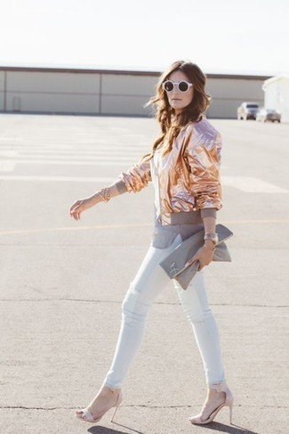 How to Wear a Grey Leather Clutch: Look stunning without really trying in a gold bomber jacket and a grey leather clutch. Complete this outfit with a pair of pink leather heeled sandals for a dose of sophistication.