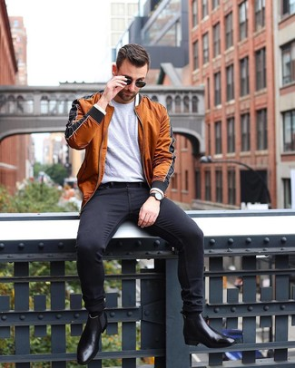 How to wear: black leather chelsea boots, black skinny jeans, grey crew-neck t-shirt, tobacco bomber jacket
