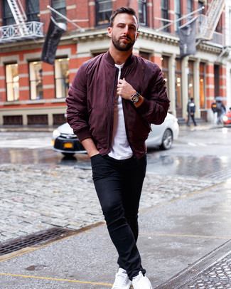 How to Wear a Burgundy Bomber Jacket For Men: For something on the cool and casual end, team a burgundy bomber jacket with black skinny jeans. This ensemble is rounded off really well with white leather low top sneakers.