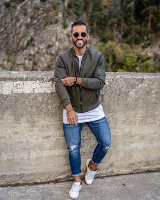How to wear: white low top sneakers, blue ripped skinny jeans, white crew-neck t-shirt, olive bomber jacket