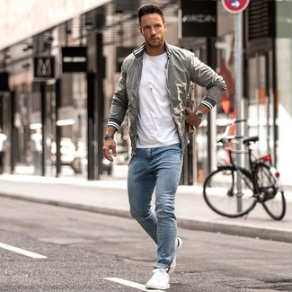 How to wear: white leather low top sneakers, light blue skinny jeans, white crew-neck t-shirt, grey bomber jacket