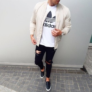 How to wear: black leather slip-on sneakers, black ripped skinny jeans, white and black print crew-neck t-shirt, white bomber jacket