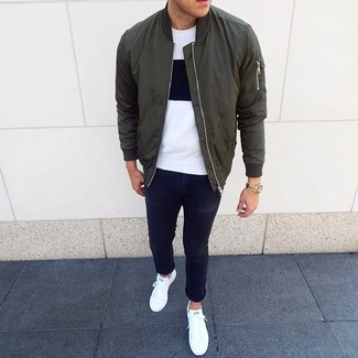 How to wear: white low top sneakers, black skinny jeans, white and black crew-neck t-shirt, olive bomber jacket