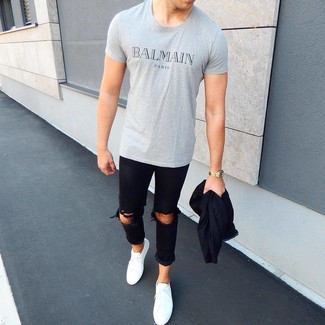 How to wear: white low top sneakers, black ripped skinny jeans, grey print crew-neck t-shirt, black bomber jacket