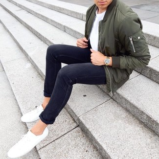 How to wear: white low top sneakers, black skinny jeans, white crew-neck t-shirt, olive bomber jacket