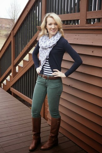 How to Wear Dark Green Skinny Jeans: This combination of a black cardigan and dark green skinny jeans combines comfort and laid-back cool. Our favorite of a myriad of ways to finish off this getup is with dark brown leather knee high boots.