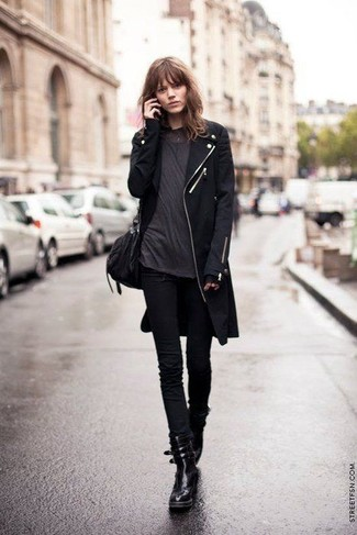 How to wear: black leather lace-up flat boots, black skinny jeans, charcoal crew-neck t-shirt, black coat