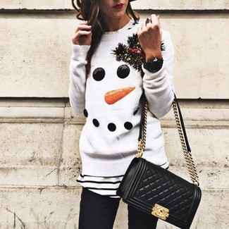 How to wear: black quilted leather crossbody bag, black skinny jeans, white and black horizontal striped crew-neck t-shirt, white christmas crew-neck sweater