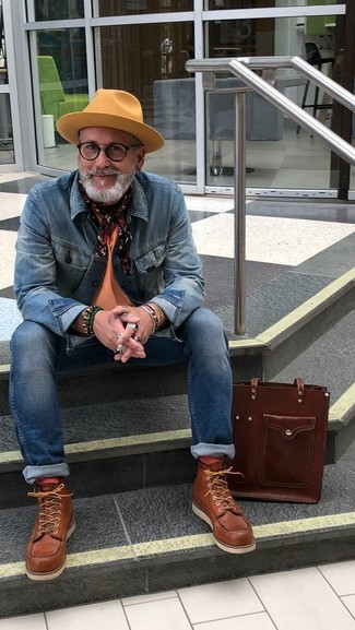 How to Wear Orange Socks For Men: Go for a pared down but at the same time casually cool getup by combining a blue denim jacket and orange socks. If you're hesitant about how to finish, introduce brown leather work boots to your outfit.