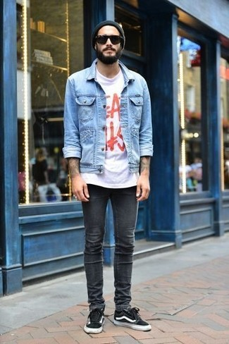 How to wear: black low top sneakers, charcoal skinny jeans, white and red print crew-neck t-shirt, light blue denim jacket