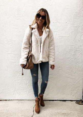 How to wear: brown suede ankle boots, navy ripped skinny jeans, white crew-neck t-shirt, white fur jacket