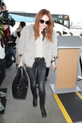 How to wear: black leather ankle boots, charcoal skinny jeans, white horizontal striped crew-neck t-shirt, grey fur jacket