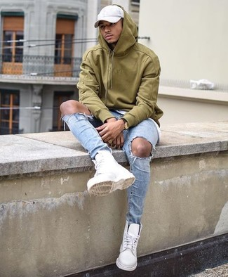 How to Wear an Olive Hoodie For Men: We're all seeking functionality when it comes to styling, and this laid-back combo of an olive hoodie and light blue ripped skinny jeans is a wonderful example of that. A pair of white leather work boots serves as the glue that ties your ensemble together.