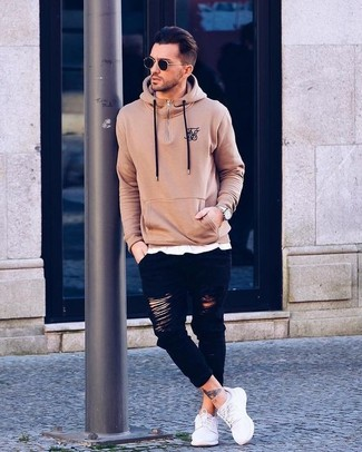 How to Wear a Tan Hoodie For Men: Infuse a relaxed vibe into your day-to-day styling lineup with a tan hoodie and black ripped skinny jeans. To introduce a bit of classiness to this getup, complete your look with white canvas low top sneakers.